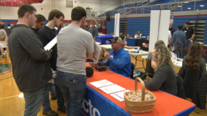 students speaking to NCTC employees at a career day event
