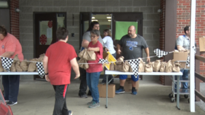 People picking up food at the Macon school nutrition program