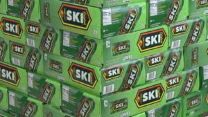 stacked cases of SKI soda
