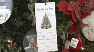 The Giving tree card on a Christmas tree
