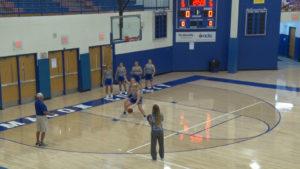 Girls playing basketball in school gym