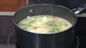 new potato asparagus soup in a pot