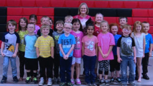 teacher with large group of kids around her