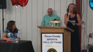 woman speaking at Macon County Sports Hall of fame induction