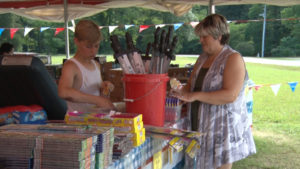woman and her young son at their fireworks stand