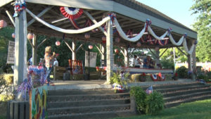 people in a decorated gazebo at the Hillbilly Days event