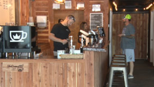 workers brewing coffee at coffee shop