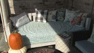 pumpkin by seat outside on deck